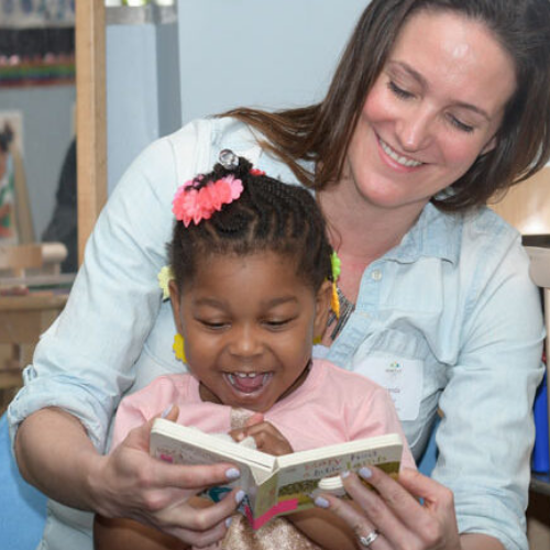 Amanda Dalnodar of Brew City Marketing reading a book to a child at the Next Door Foundation